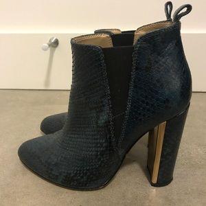 BCBG snakeskin booties